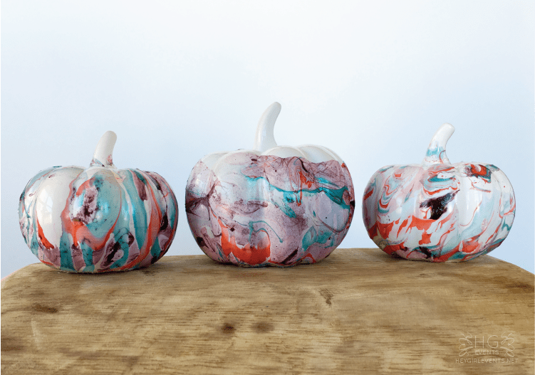 These DIY Marbled Ceramic Pumpkins are so beautiful and chic. They would look great in your fall decor or on your Thanksgiving table! See more at http:/ablissfulnest.com/ #Fall #Pumpkins #Marbled