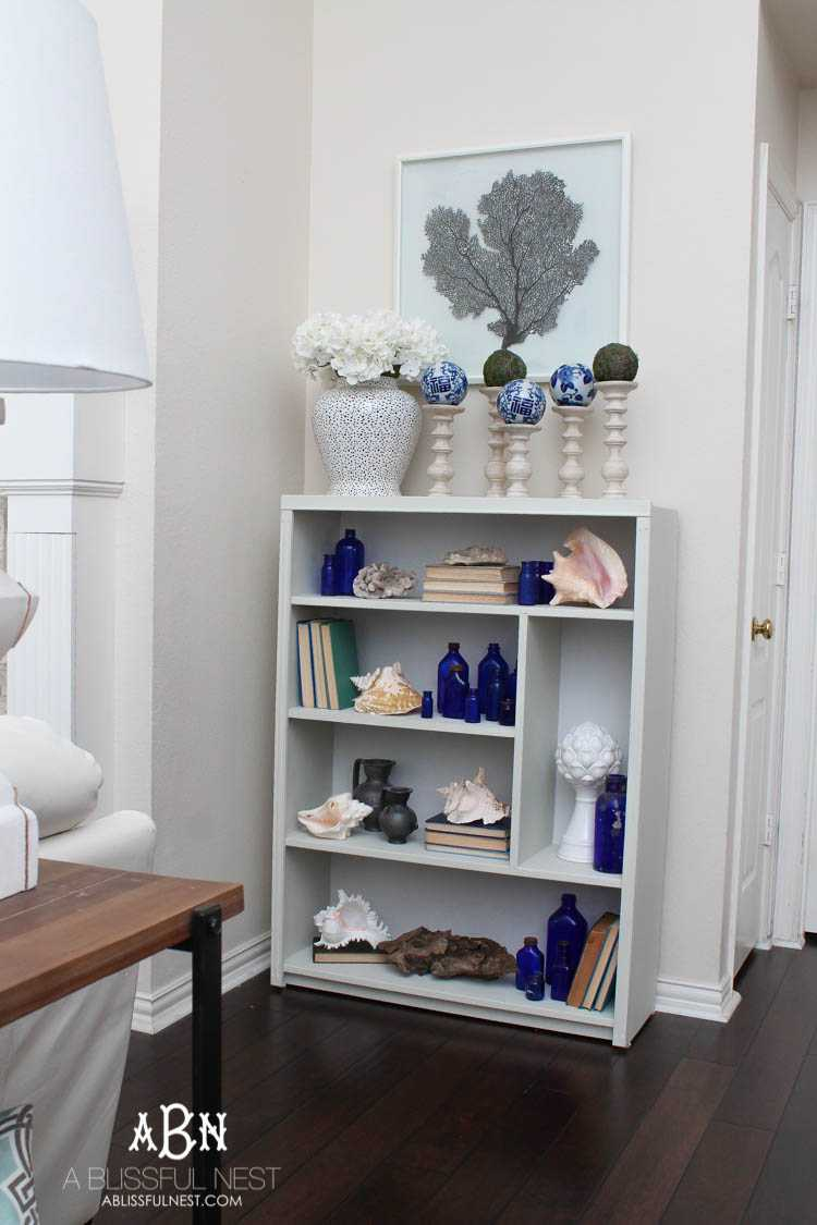 Got an old bookcase that needs to be updated? Checkout how this bookcase went from boring to fabulous with just a few easy steps! See more on https://ablissfulnest.com/ #bookcasemakeover #diybookcase #chalkfurniturepaint