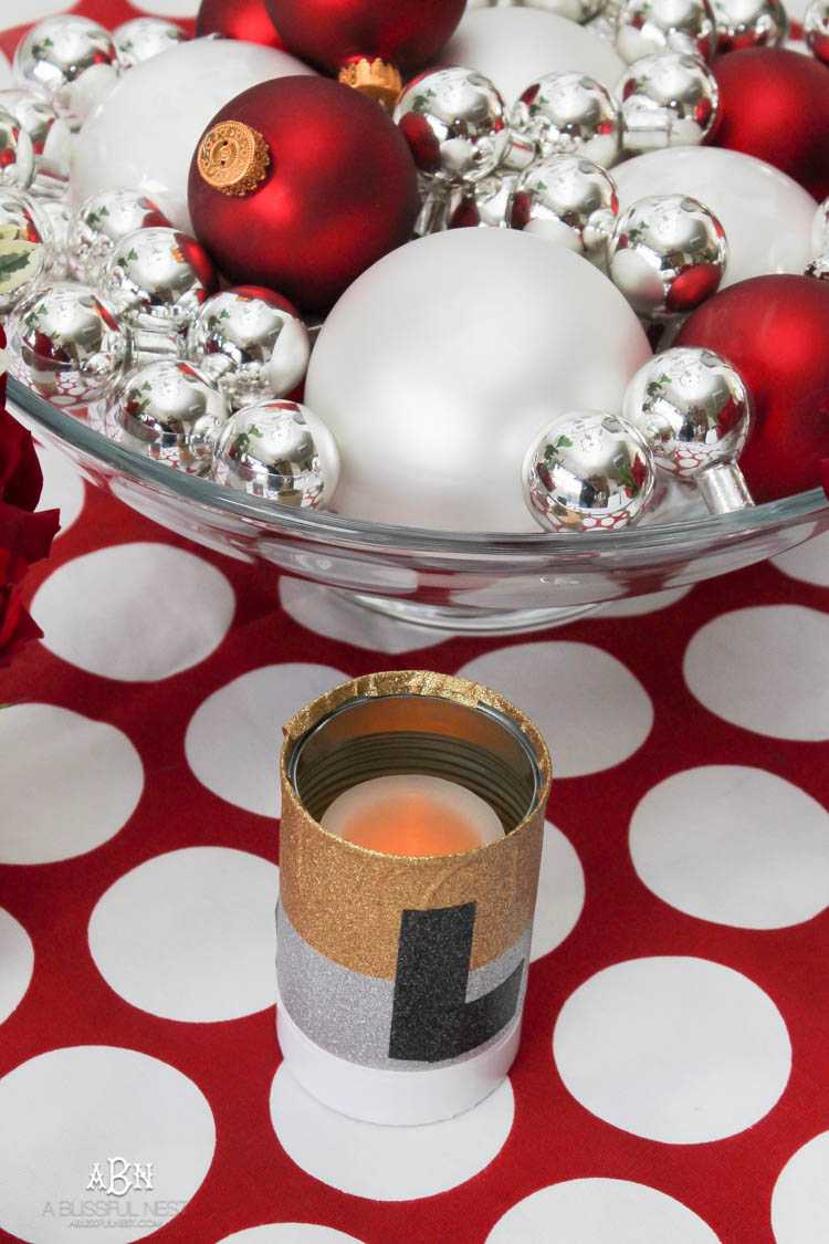 With the holidays fast approaching, create this simple DIY holiday table décor using Duck Tape. See more on https://ablissfulnest.com/ #christmascraft #holidaytabledecor #christmasdecorating