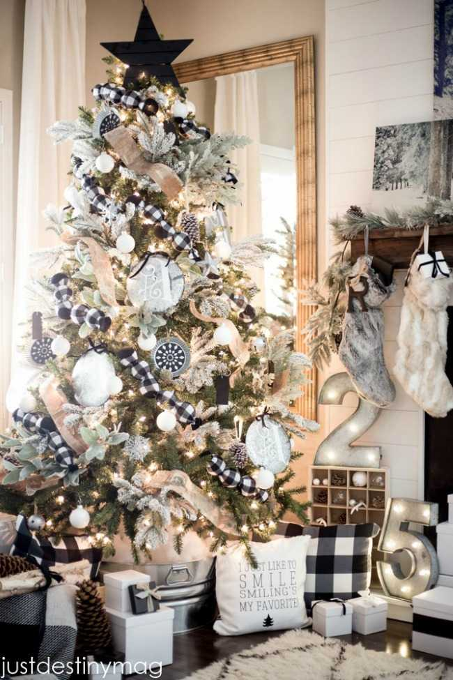Black and white plain and a bold black star make this Christmas tree a true show stopper