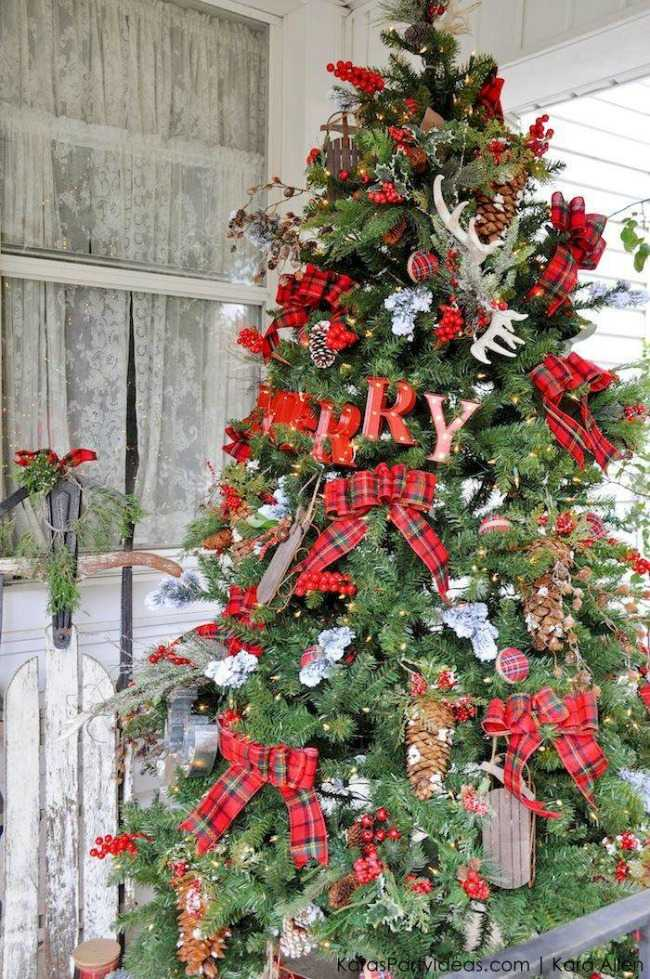 This mountain getaway tree is accented with rustic plaid and farmhouse decorations to look like this tree came straight out of your Up North cabin