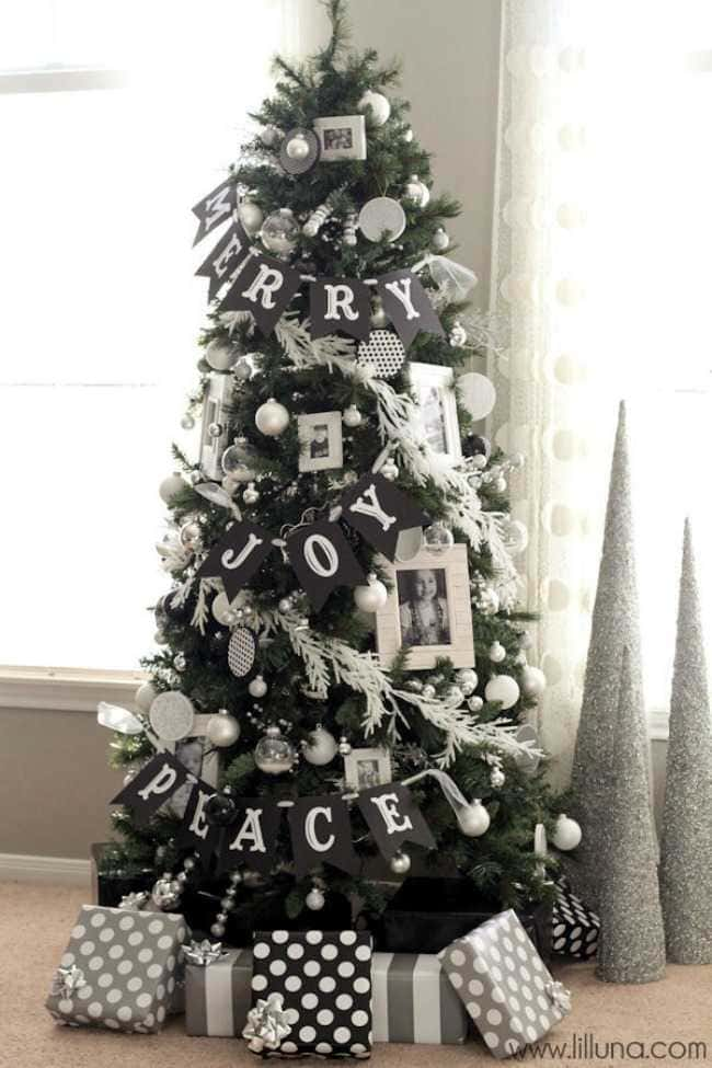 Black and white photographs used as christmas tree decoration give this gorgeous tree a personal touch