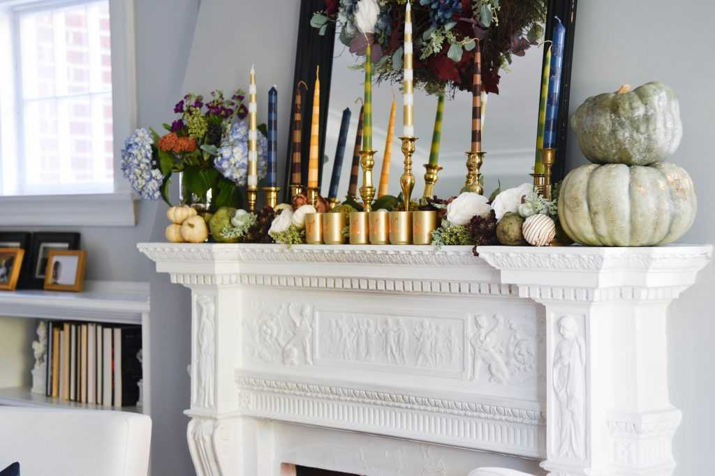 Learn how to make your own striped taper candles and painted votive candle holders for any occasion. A gorgeous Thanksgiving mantel brimming with color. See it all at https://ablissfulnest.com/ #Thanksgiving #DIY #HolidayDIY