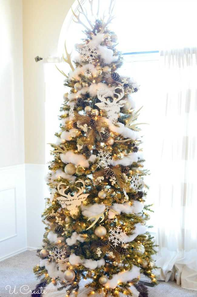 This his and hers tree is a perfect mix of soft and glittery garland with rustic country decorations