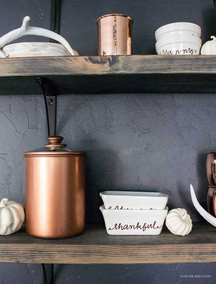 Skip the expensive price tag on authentic copper and create a set of DIY painted copper canisters for a fraction of the cost! See all the details at https://ablissfulnest.com// #Copper #UpcycledProjects #CopperDecor