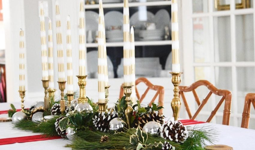 Here are some amazing tips to create the most beautiful budget Christmas Tablescape. You are going to wow your guests! See it all on https://ablissfulnest.com// #Christmas #BudgetDecor #ChristmasTablescape