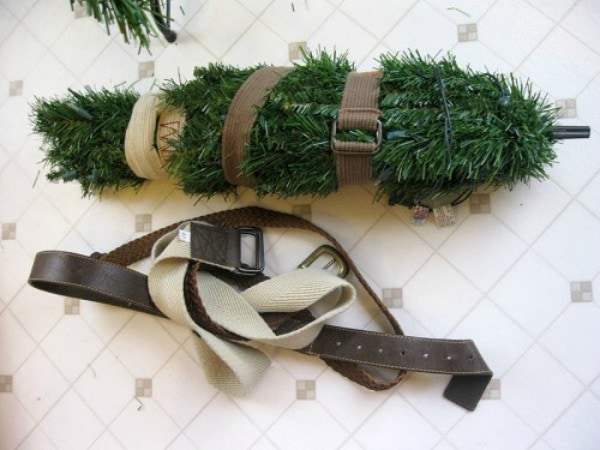 Christmas Decor Storage solutions - protect your christmas tree by wrapping belts around the branches.