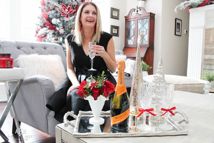 Grab a bottle of Mionetto Prosecco for the ultimate luxury for your holiday gatherings! Get the details on this delicious drink. See more on https://ablissfulnest.com/ #holidayentertaining #holidaydrink