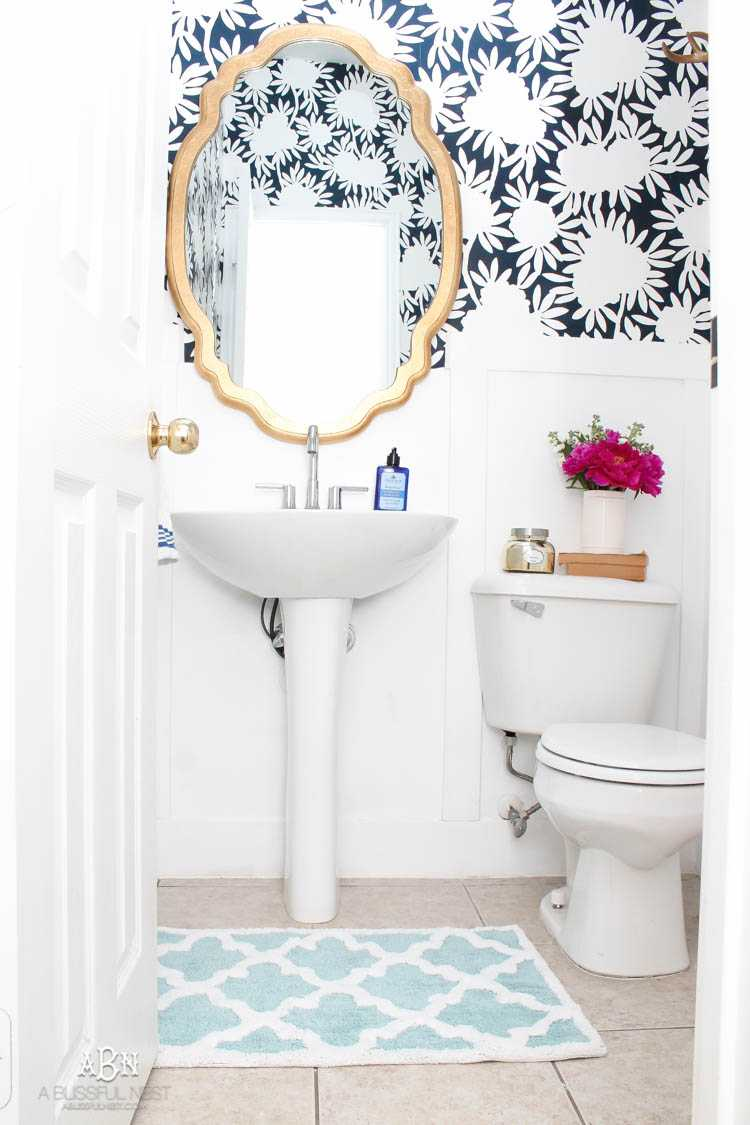 This is such a huge transformation on this bathroom with not many updates. Checkout how with a few simple changes you can get a wow factor bathroom remodel. See more on http://ablissfulnest.com/ #bathroomremodel #bathroommakeover #ad #deltafaucet