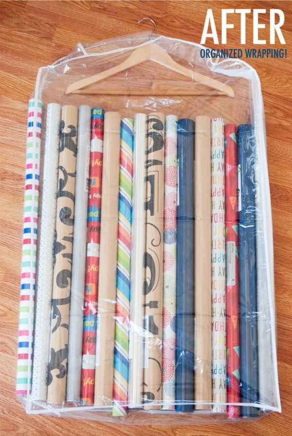 Christmas Decoration Storage solutions - keep inventory of wrapping paper by storing rolls in garment bags with hooks.