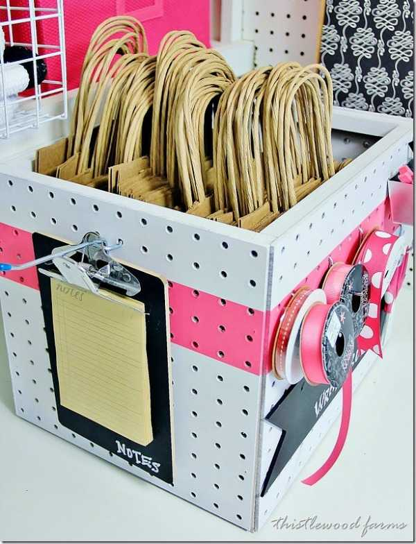 Christmas Decoration Storage solutions - organize your gift wrap station with milk crates and peg board.