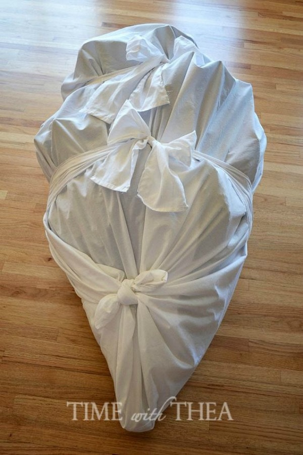 Christmas Decoration Storage solutions - spare sheets can be used to wrap and store fake christmas trees.