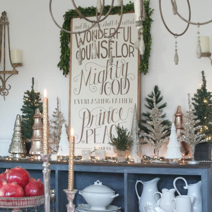 Set a beautiful Christmas Table Scape when you layer beautiful linens and dishes for a show stopping display. This holiday table is beautiful! See all the details on http://ablissfulnest.net #Christmas #Tablescapes #HolidayTables