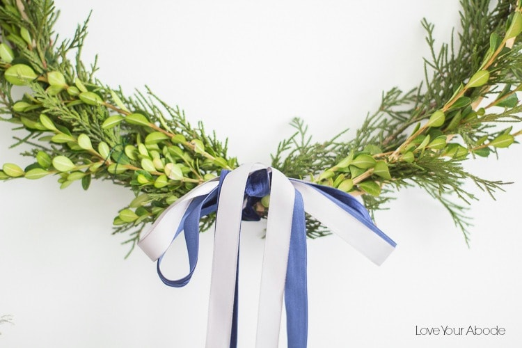 A simple and minimal DIY Foraged Wreath for the holidays! See all of the info http://ablissfulnet.com #Wreaths #HolidayDecor #MinimalDecor