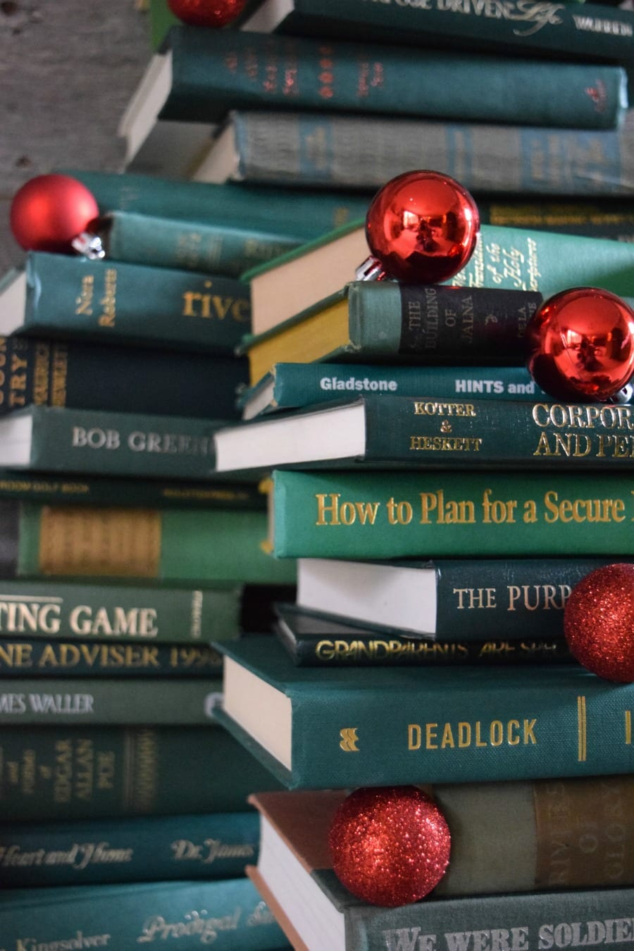 Collect Books for a DIY vintage inspired book Christmas tree. See how to make it at https://ablissfulnest.com/ #Christmas #ChristmasDecor #DecoratingWIthBooks