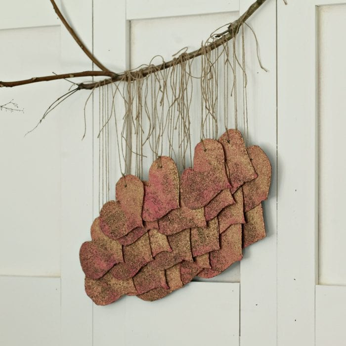 Use leftover roofing shingles to create a beautiful and whimsical boho hearts wall hanging. See more at https://ablissfulnest.com/ #ValentinesDay #Hearts #ValentineDecor