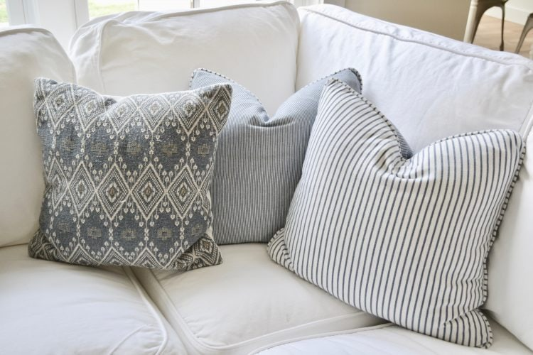Refresh your home for the new year with new pillows in warm, inviting colors like these grey scale, simple pattern fabrics.