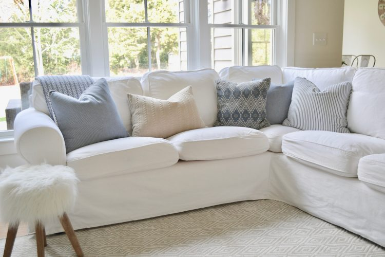 This bright, crisp couch with cool grey pillows and simple pattern fabrics go a long way in helping you refresh your home in the new year!