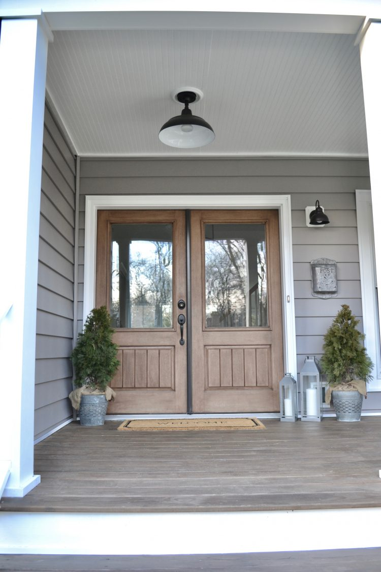 Refresh your home in the new year with simple, clean, and minimal decorations! These mini spruce bushel planters look great on this porch.