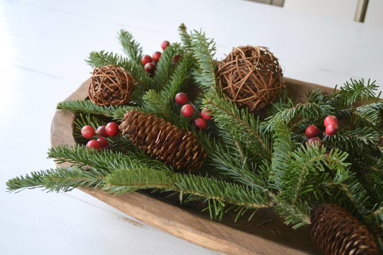 A pop of red and green color will refresh your home with this simple and wintery dining room table centerpiece.
