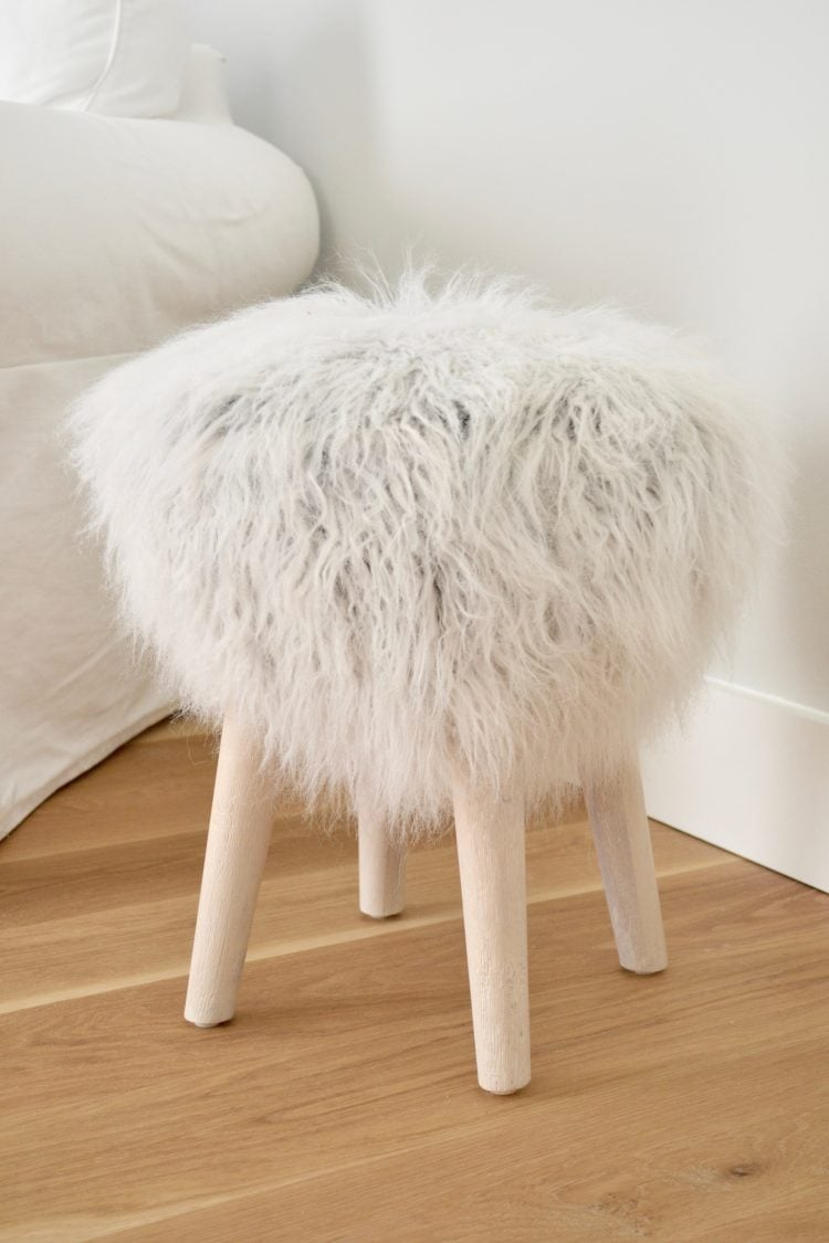 Refresh your home in the new year with one new statement piece of furniture! This faux fur ottoman is the perfect addition to your refreshed living room.
