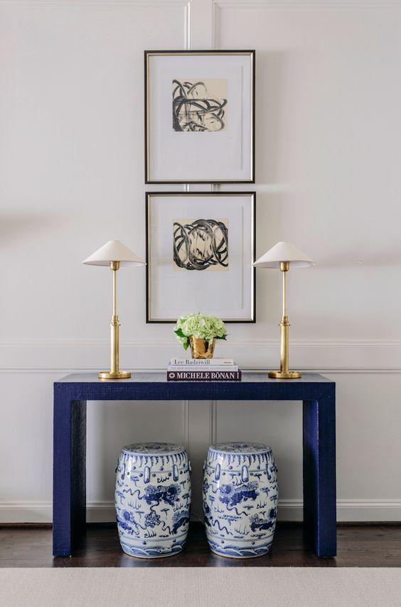 Easy ways to style a console table by adding height, seating, and accessories. for more ideas go to www.ablissfulnest.com #interiors #tips