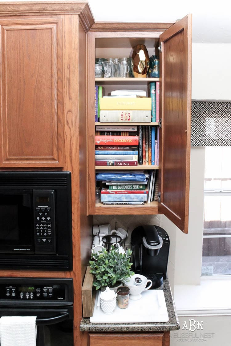 This is such a great idea! Transform a dead cabinet space with these coffee cabinet organization ideas! See more on http://ablissfulnest.com/ #coffee #coffeestation