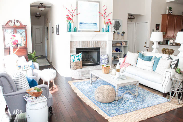 It's time to redecorate for spring! Love this fresh and inviting spring living room! See more on https://ablissfulnest.com/ #springdecorating #livingroom