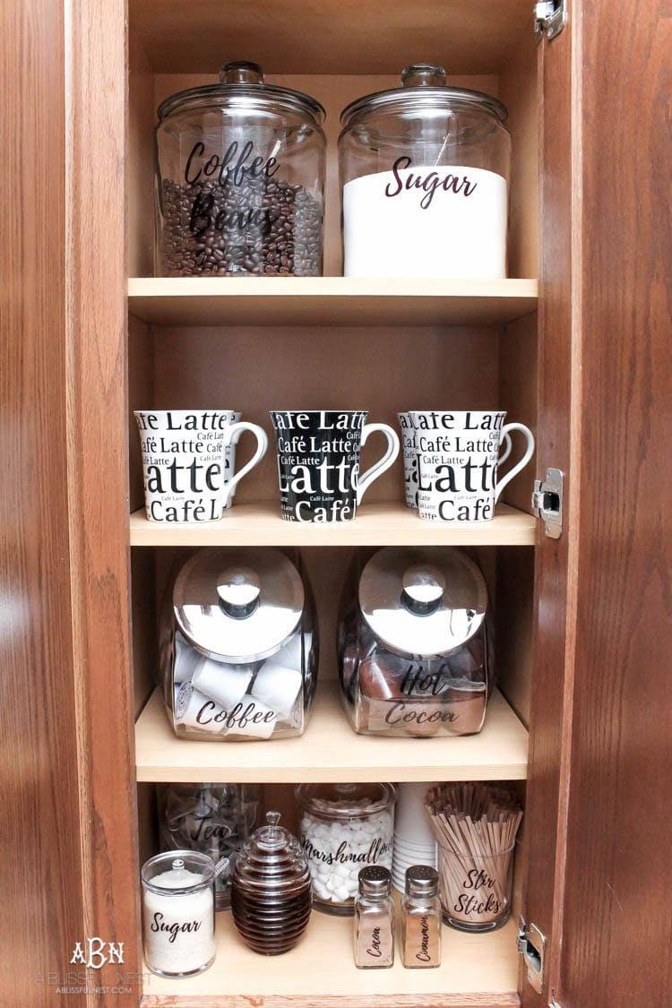 This is such a great idea! Transform a dead cabinet space with these coffee cabinet organization ideas! See more on https://ablissfulnest.com/ #coffee #coffeestation
