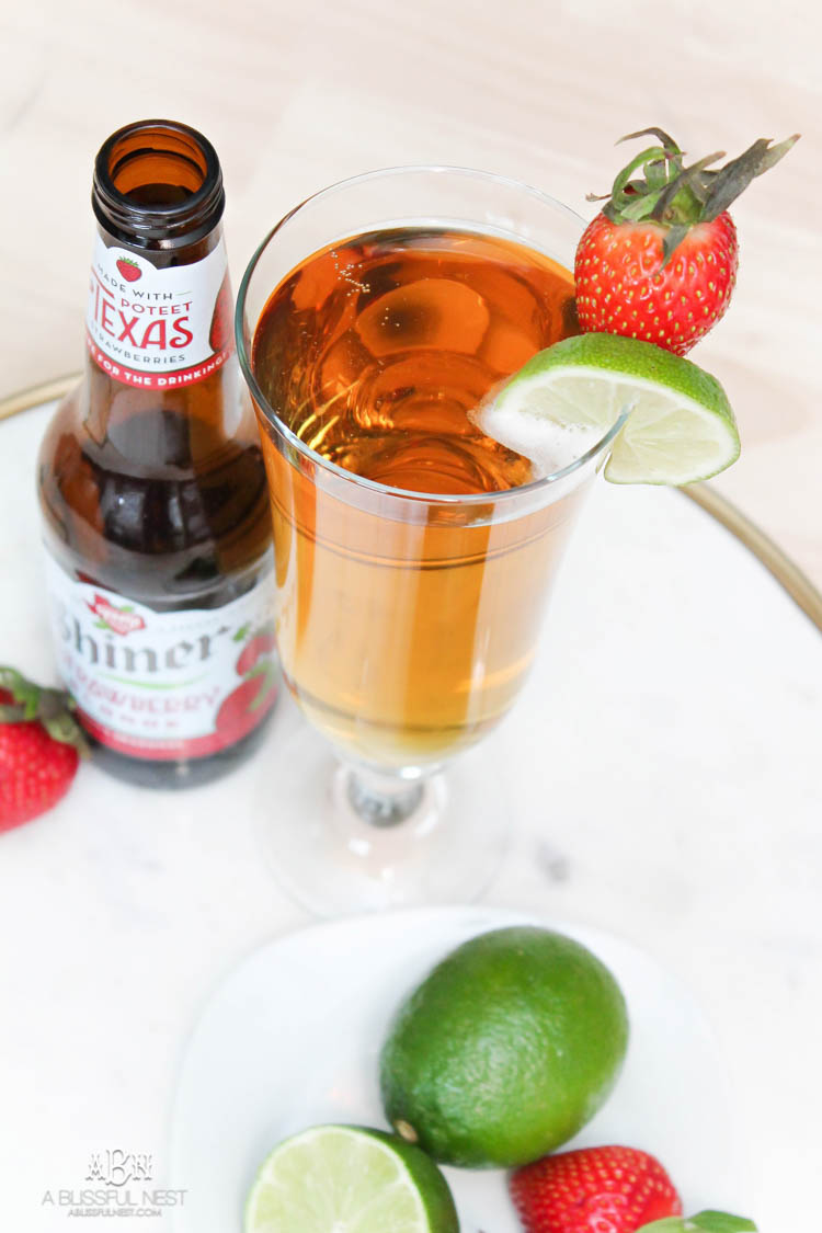This is such a delicious beer cocktail recipe! Love the mix of strawberries and lime. See more on https://ablissfulnest.com/ #ad #totalwine #cocktailrecipe