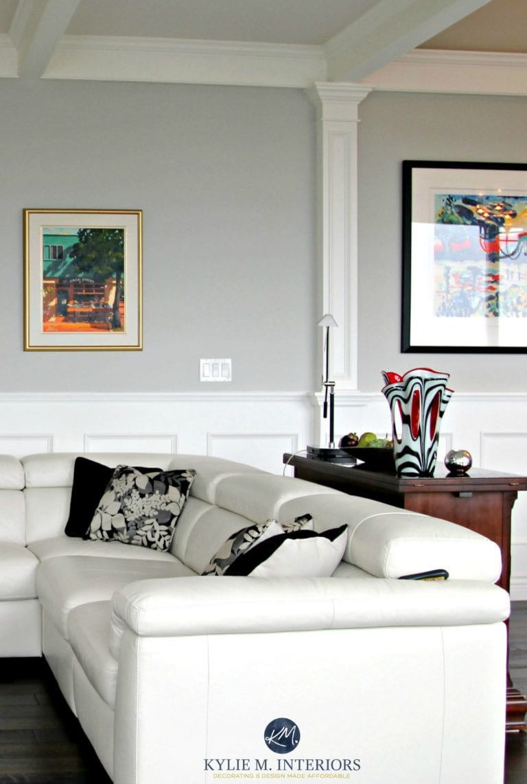 benjamin moore stonington gray in a contemporary living room with white leather couch black accents and white wainscoting kylie m interiors 768x1143 56248