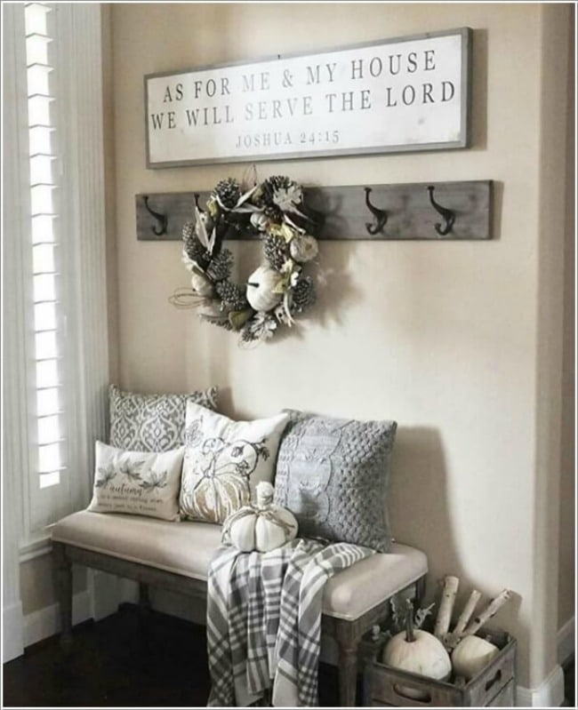 Adore this fall entryway by Magnolia Homes. Grab the best fall entryway ideas on https:ablissfulnest.com/ #falldecor #falldecorating #fallentrydecor