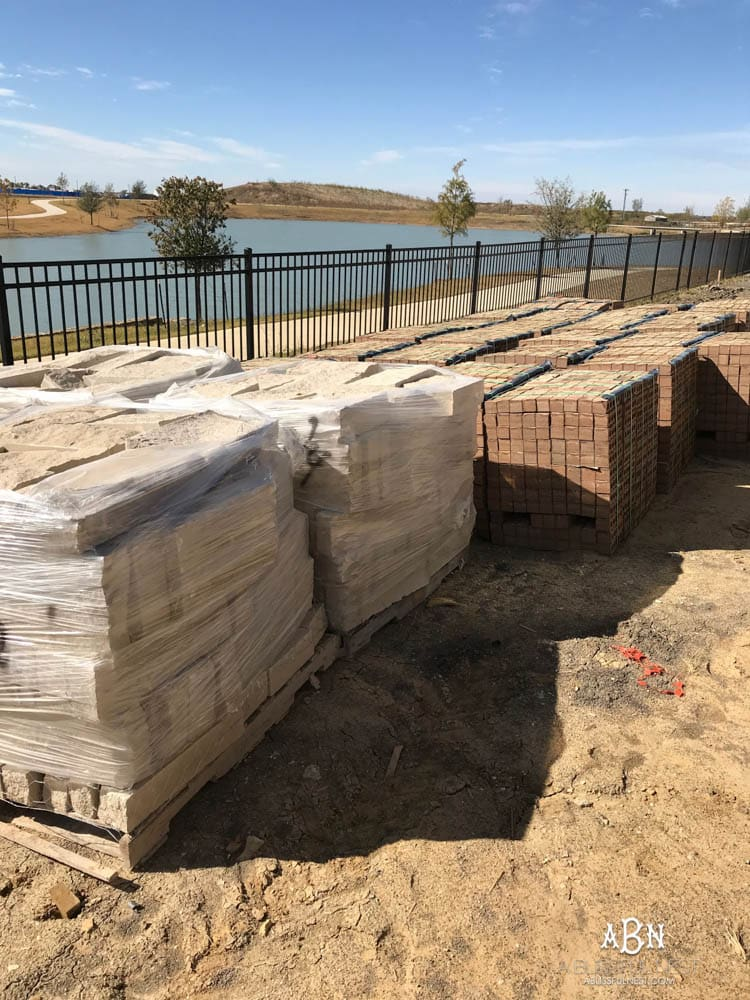 All these pallets of brick and stone for the exterior of our new home were delivered to our backyard! Excited to get started! Want to know how to choose brick for your home? Take it one step at a time with this helpful guide.