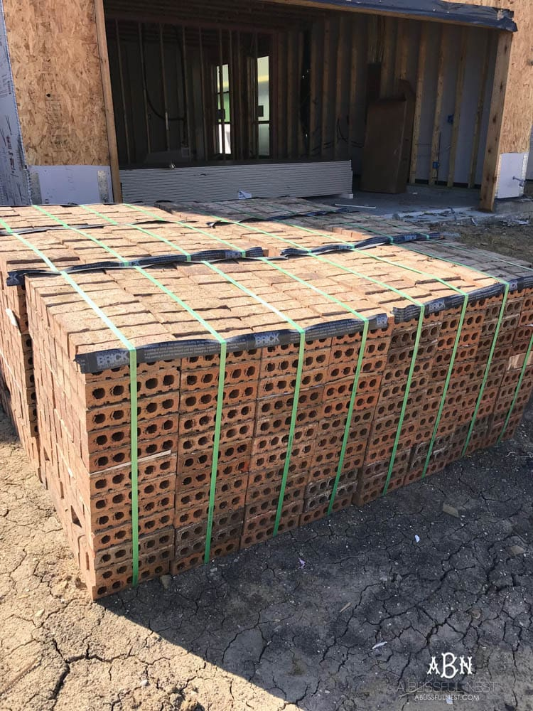 All of these pallets of brick will come together to make the exterior of our new home look amazing! Struggling with how to choose brick for your home? You have so many options - here's where to start!