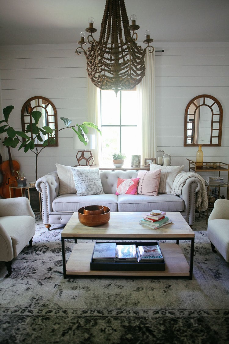These throw pillows go from larger to smaller size from the outside to the inside of the couch, giving the display a cohesive look that fits the size of the couch