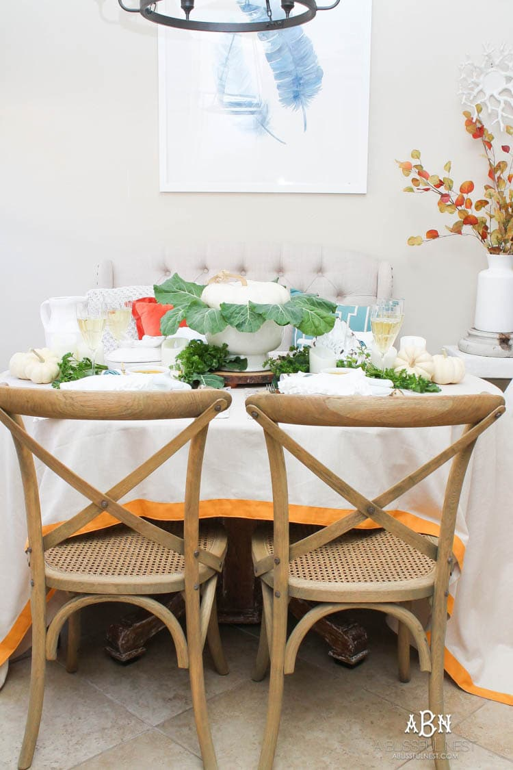 Tips to set a simple traditional Thanksgiving table with pops of color! Lots of sources for recreating this! #Thanksgiving #Thanksgivingdecor #holidaytable #ad #TuesdayMorning