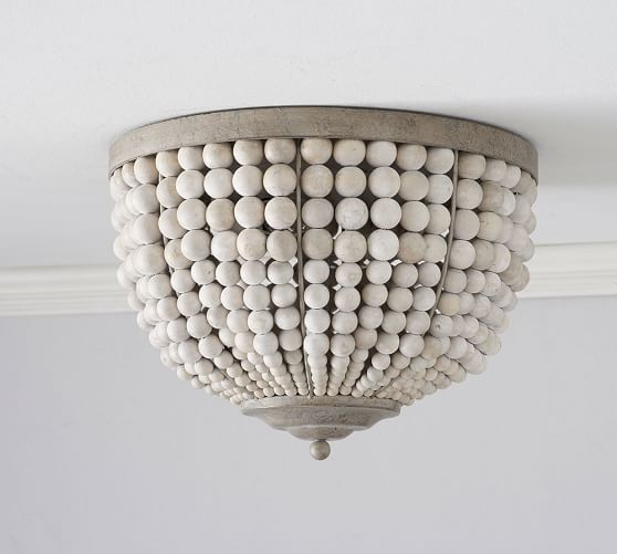 Love the whitewashed look to this beaded light fixture. #lighting #bathroom #bathroomideas