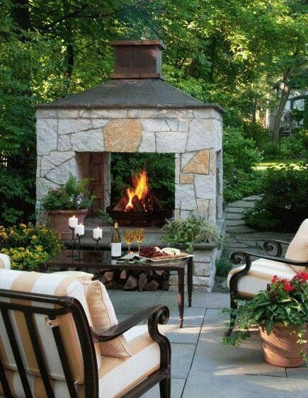 In love with this gorgeous outdoor fireplace! #outdoorspace #outdoorfireplace #backyard