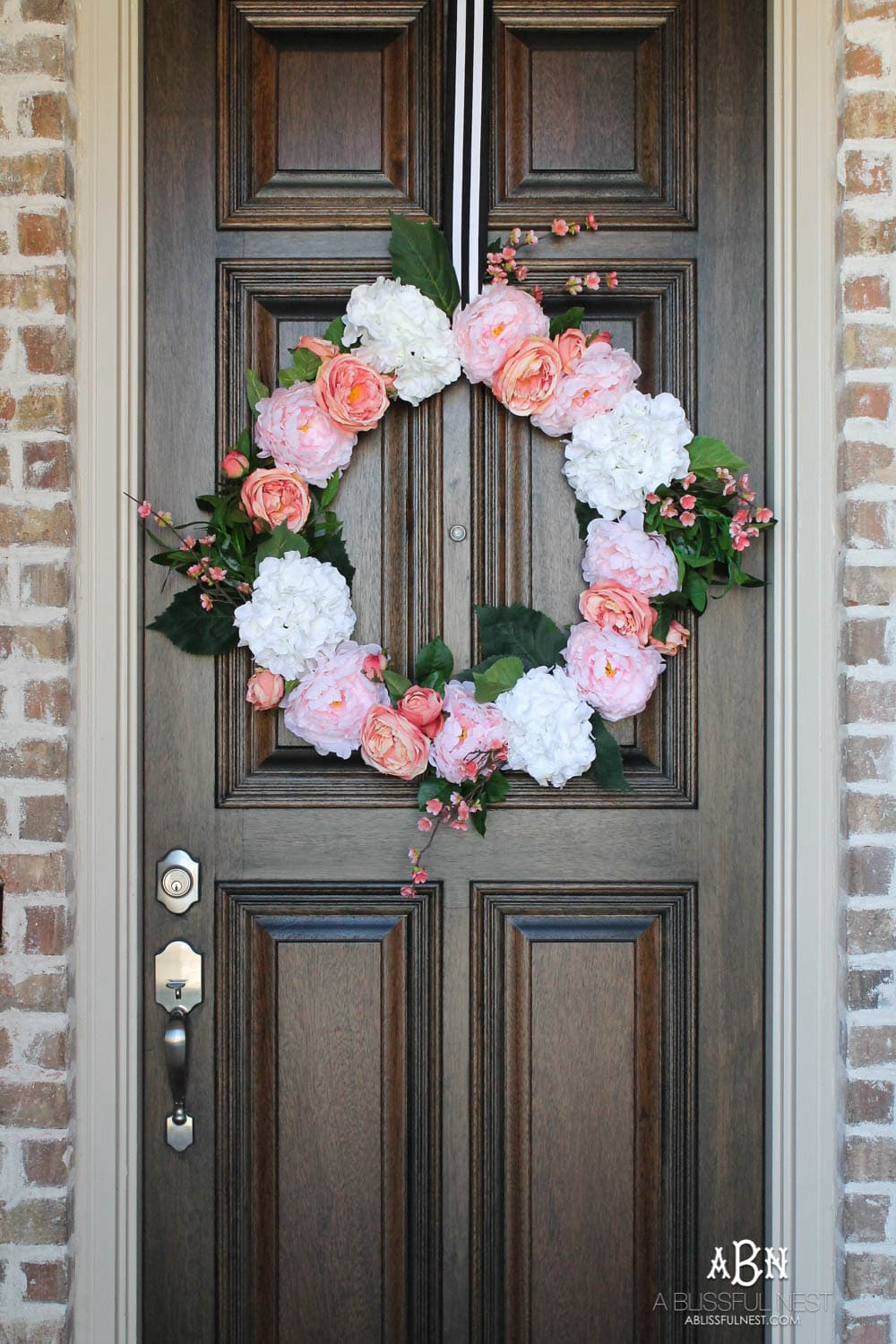 Easy steps to make this gorgeous peony flower wreath. #springwreath #diytutorial #flowerwreath #wreathtutorial