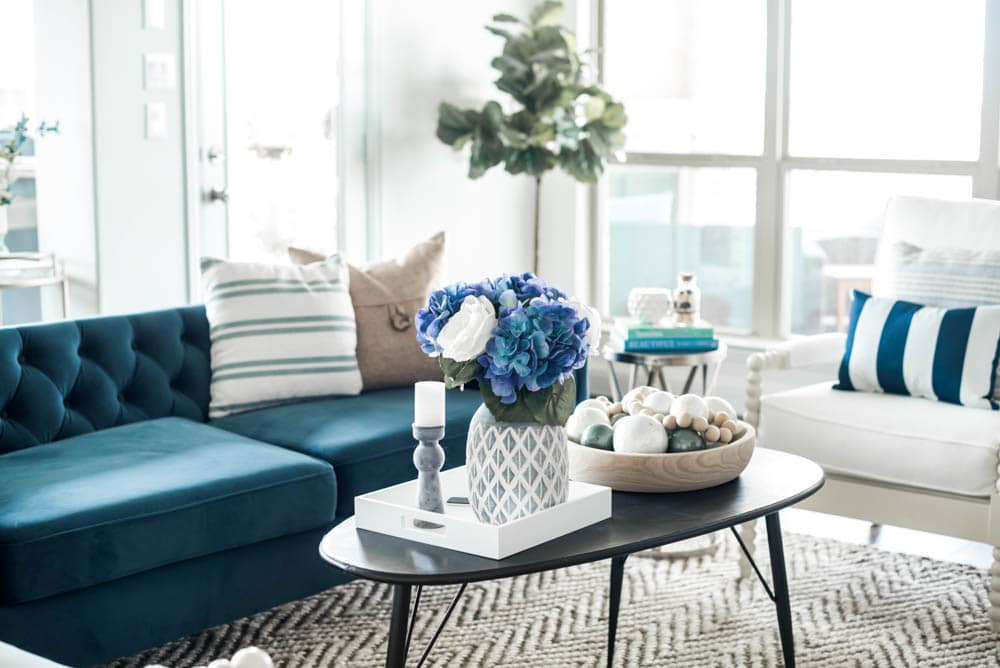 Beautiful coastal living room decor + sources to recreate this living room look. #coastaldecor #livingroomideas #ABlissfulNest #livingroom #coastalhomedecor