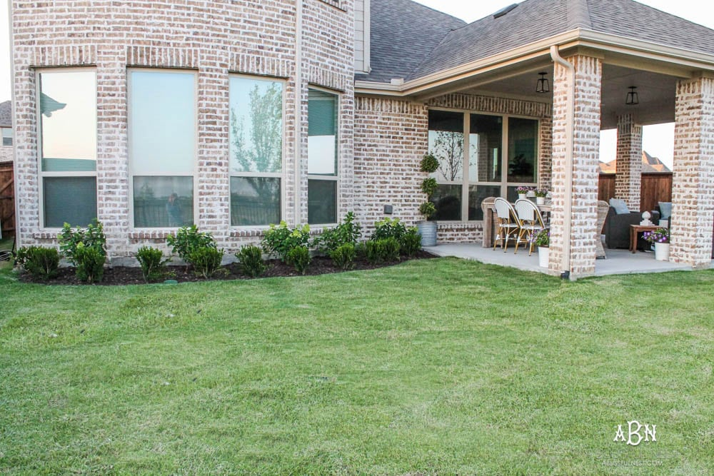 A small backyard makeover before and after with ideas on small backyard landscaping ideas. #ad #husqvarna #backyardideas #brickhouse #landscaping