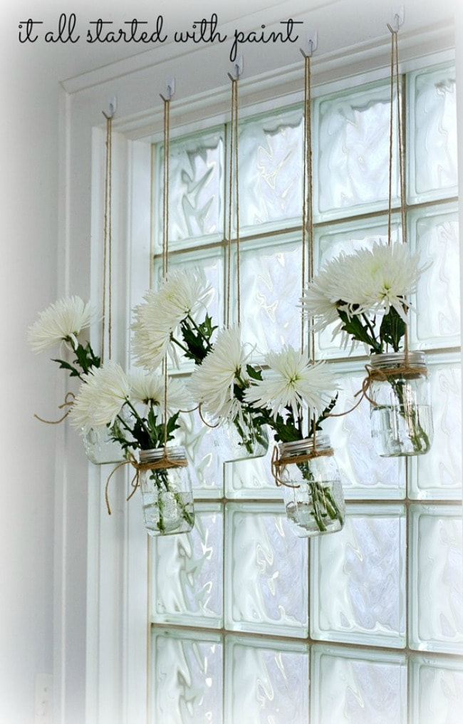 Bring fresh flowers indoors by hanging mason jars in front of the window! It All Started With Paint, 15 Things to do with Command Hooks in your Home via A Blissful Nest