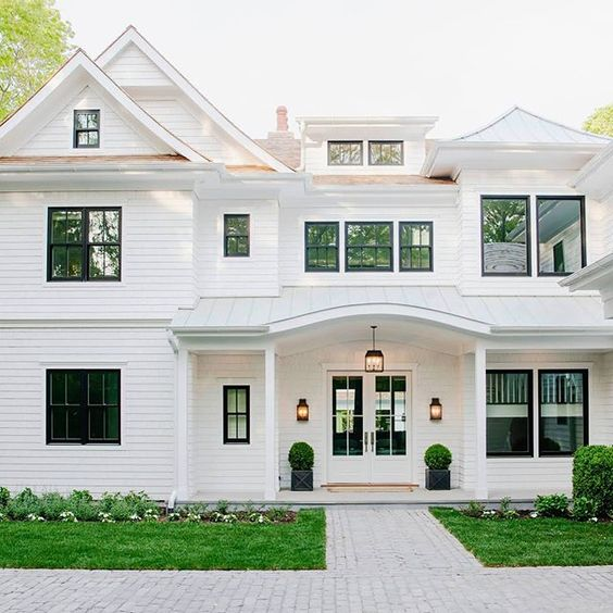 Gorgeous white house with black trim for a modern fresh coastal feel.