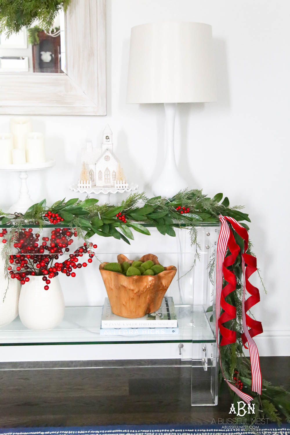 Pop holiday berries into your existing décor. Beautiful pop of color in this classic Christmas décor in this entryway. #christmasentryway #christmasentry #christmasentrydecor #christmasentrywayideas #christmashometour