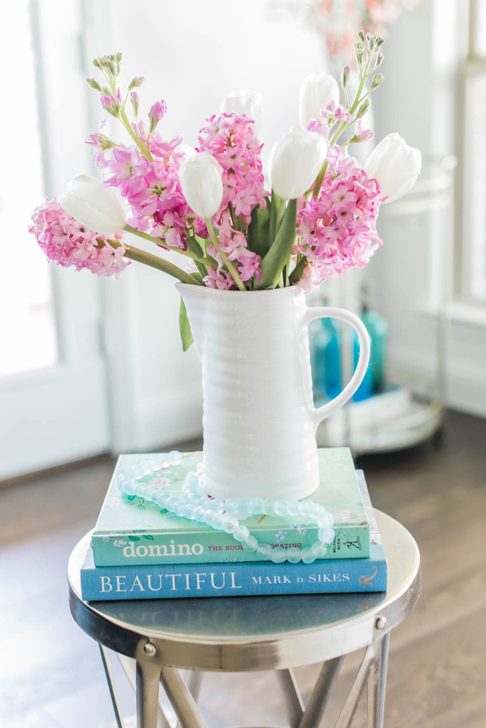 Add colorful books to your spring decor. #ABlissfulNest #springideas #springdecor