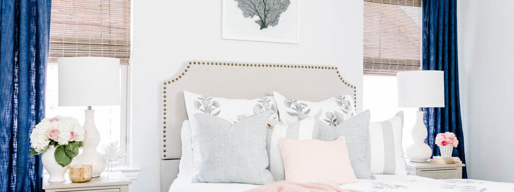 Blue and blush bedroom with navy accents. Summer decorating ideas for a bedroom or a guest bedroom. #ABlissfulNest #summer #guestbedroom #bedroomideas