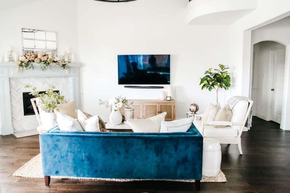 Navy sofa and neutral fall decor. Simple fall decorating tips to get this modern coastal look. #ABlissfulNest #falldecor #livingroomideas #fallinspiration