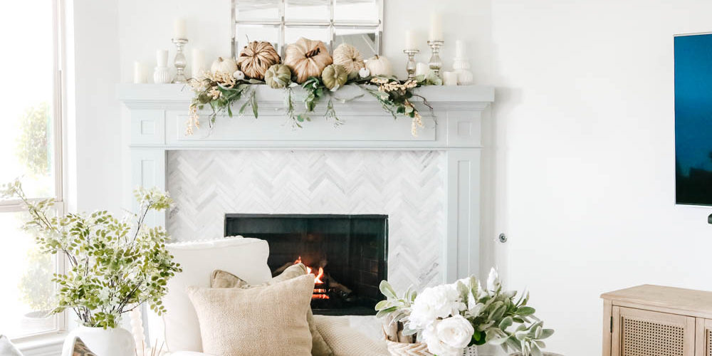 Coastal fireplace mantle decorated for fall. Natural pumpkins, neutral fall decor ideas for the living room. #ABlissfulNest #falldecor #falldecoratingideas #livingroomideas #fireplacemantle
