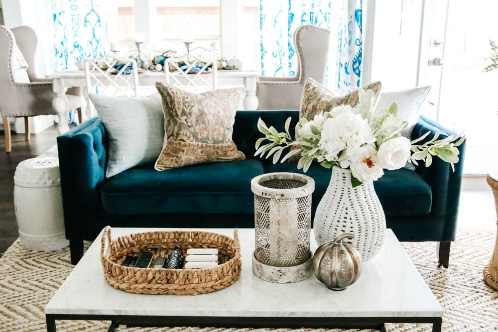 Neutral fall decor with navy sofa and pops of blue in a coastal inspired living room. #ABlissfulNest #fallhometour #falldecor #fallinspiration #livingroomideas