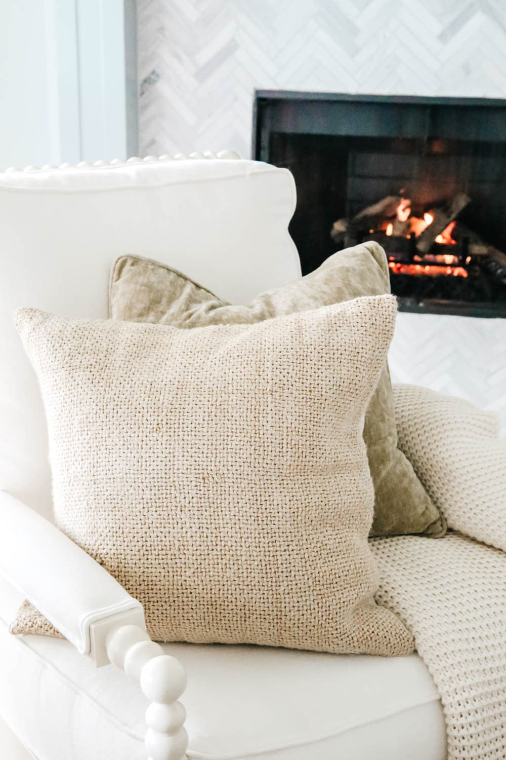 Mixing sage and tan colors for pillows in this neutral fall home tour. #ABlissfulNest #fallhometour #falldecorating